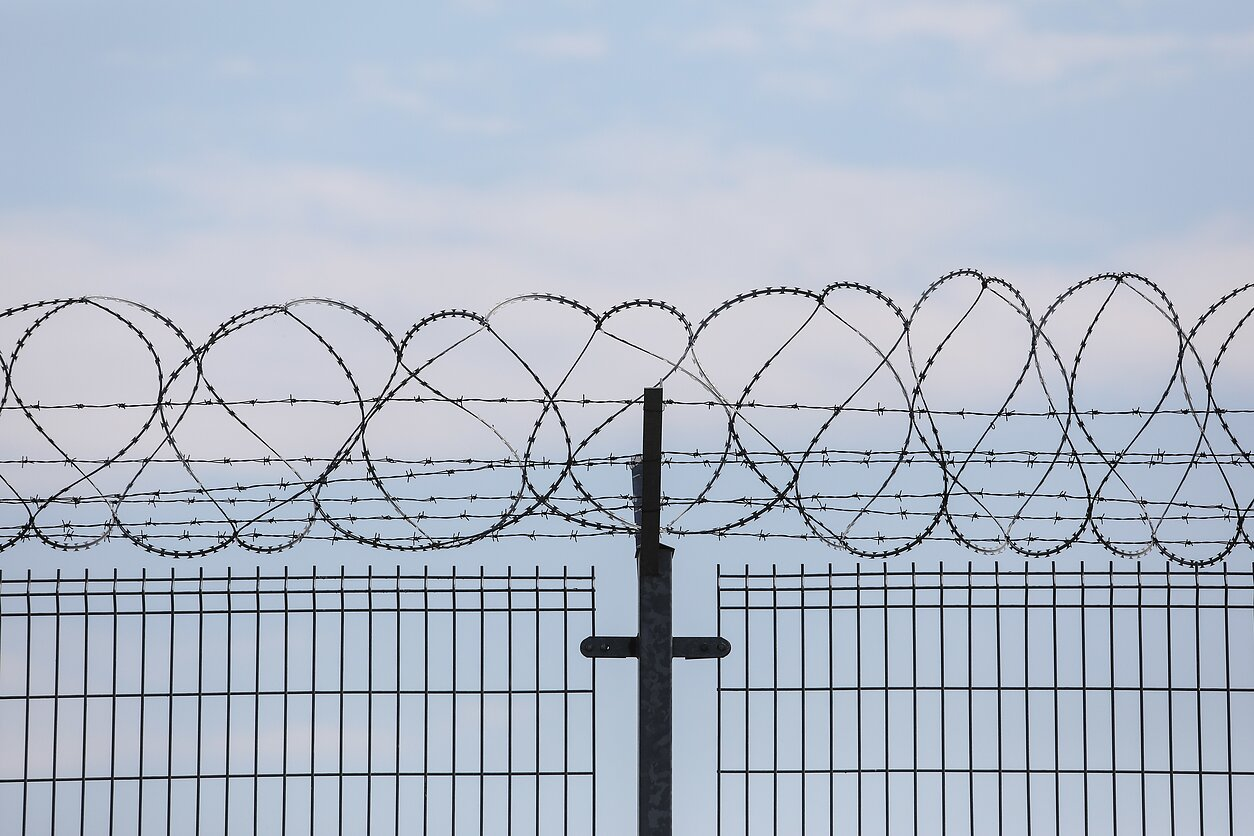 A barbed wire fence (associative image)