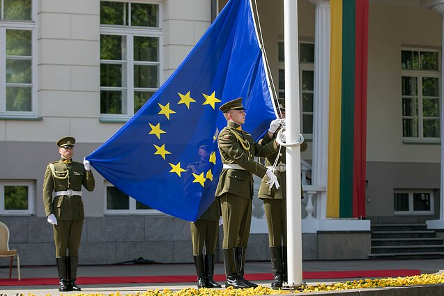 EU flag being hoisted outside the President's Palace