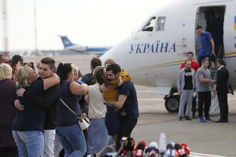 Ukrainian detainees return home after a prisoner-swap with Russia