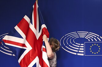 British flag being prepared for a press conference in Brussels