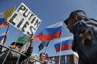 Russian flag during a protest in Moscow