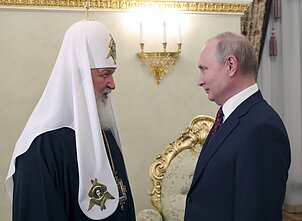 Russian President Vladimir Putin, right, and Russian Orthodox Church Patriarch Kirill