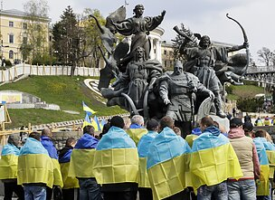 People with Ukrainian flags in Kyiv