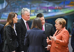 Gitanas Nausėda and other EU leaders speaking with German Chancellor Angela Merkel