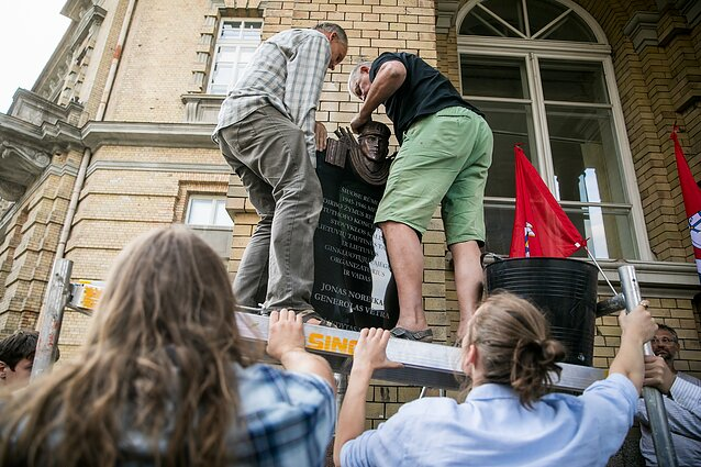 Protesters reinstall a plaque to Jonas Noreika, a controversial Lithuanian WW2-era military officer who is accused of collaborating with the Nazis