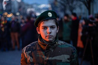 A youth member of the Riflemen's Union near a bonfire