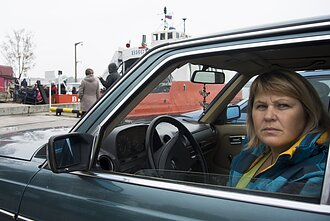 A woman awaits a ferry in Baltiysk, home to Russia's Baltic Fleet in Kaliningrad