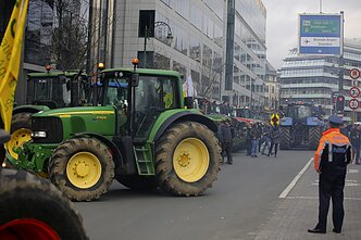 Tractors from Baltic farmers are parked outside of the EU summit in Brussels
