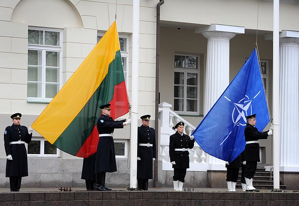 Lithuanian and NATO flags hoisted outside the president's palace