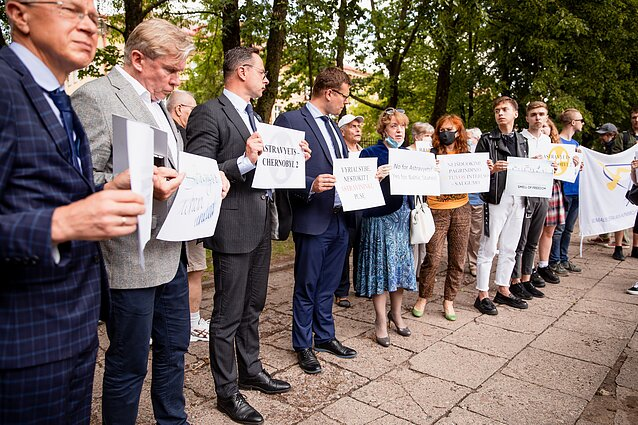 Lithuanian MPs protest outside Latvian embassy, calling to join Belarusian electricity embargo.