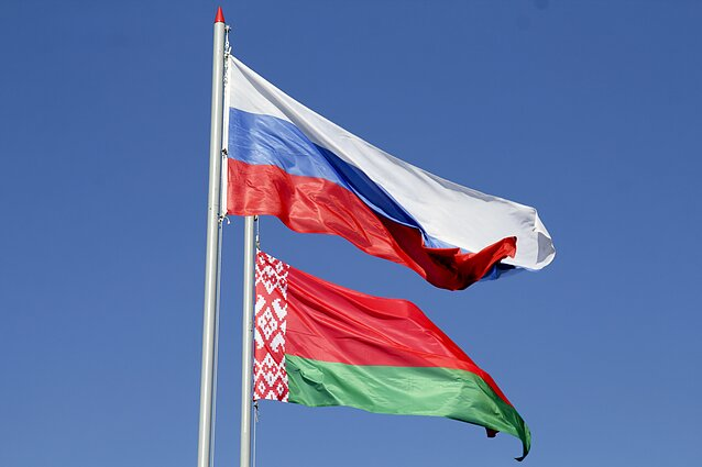 The flags of Belarus and Russia.